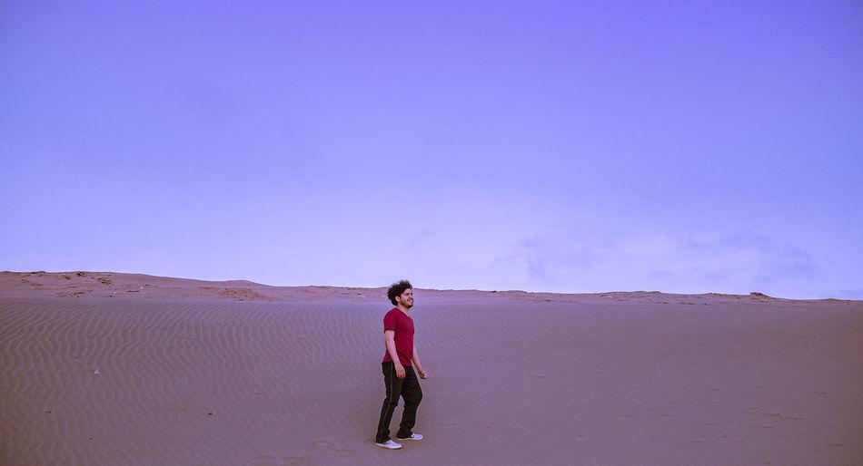 Full length of man standing on arid landscape