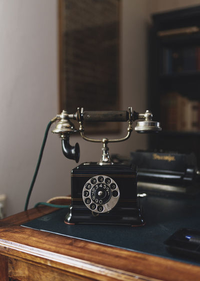Antique Analog Antique Close-up Communication Connection Focus On Foreground History Indoors  Metal No People Old Retro Styled Selective Focus Still Life Table Technology Telephone Telephone Line Vintage Wood - Material