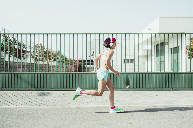 Full length side view of a woman running