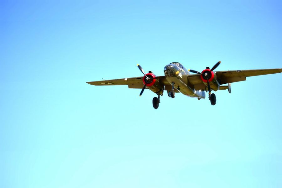 B-25 Mitchell WWII aircraft Flying Clear Sky Low Angle View Air Vehicle Airplane Mid-air Blue Transportation Day Motion Sky Outdoors No People Copy Space WWII Warplane History Airshow Military Airplane Military Clear Sky No Budget Photography