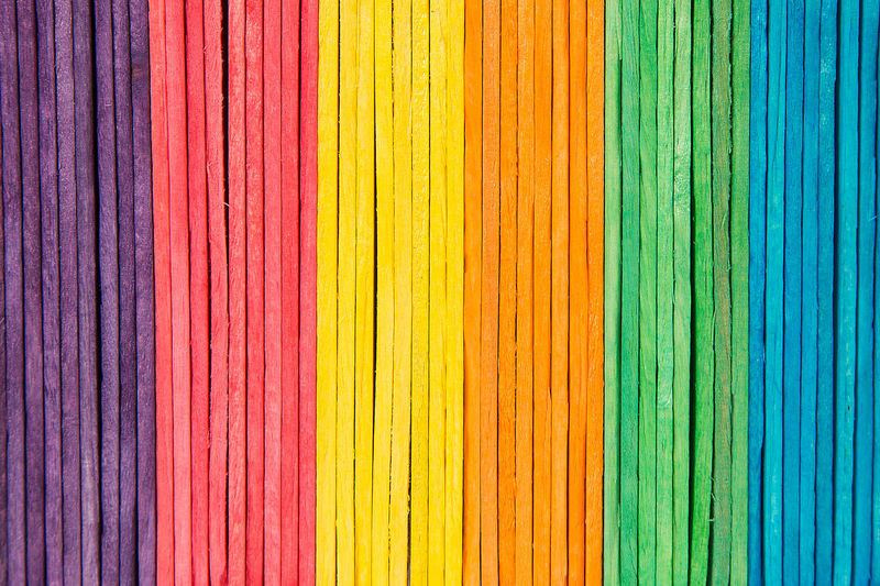 colorful of Ice cream sticks arranged. Objects Backgrounds Close-up Colorful Full Frame Ice-cream In A Row Multi Colored Object Pattern Popsicle Side By Side Stick Textured  Toy Wood - Material Yellow