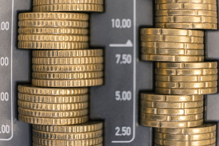 Close-up of stacked coins in cash box
