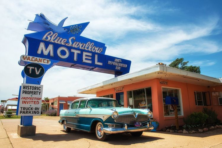 Text Car Sky Day Landmark Outdoors Lights Land Vehicle No People Architecture Building Exterior Tucumcari New Mexico Route 66 Hotel Icon Oldtimer Historic Motherroad Famous Route 66 Sign Scenic Old Neon Glow