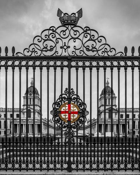 Metal gate against building