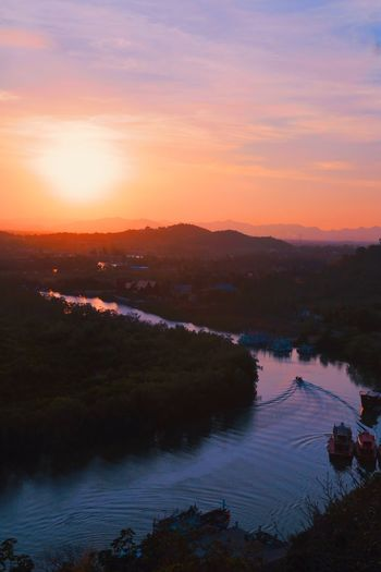 High angle view of river against sky during sunset