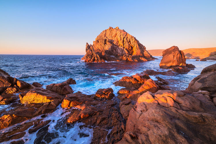 Sugarloaf Rock at sunset Water Sky Beauty In Nature Tranquility Tranquil Scene Scenics - Nature Nature No People Sea Land Rock - Object Rock Formation Ocean Outdoors Landscape Seascape Sunset Evening Colorful Colors Australia Travel Destinations Travel Flowing Water Dusk