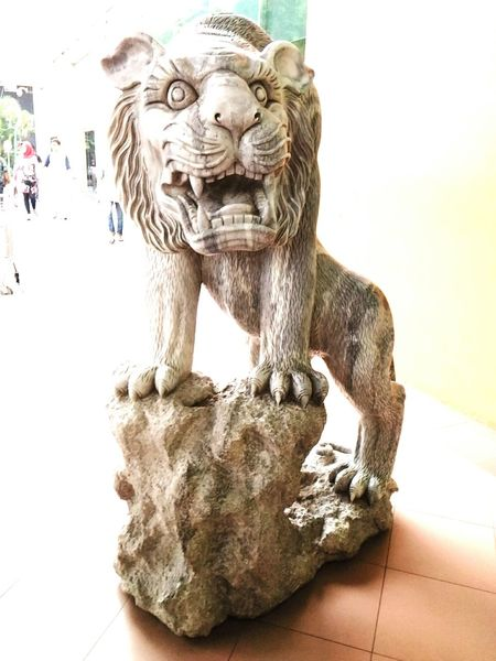 Statue of a lion at Botani Square Sculpture Animal Representation Art And Craft Engravedstatue Engraved Stones Engravings Engraved In The Rock Engraving Mascot Animal Photography Lion Sculpture Statue Statue Colection Statues/sculptures Statue In The City Statues Mobile_photographer Photography Photoshop Photoshoot Mobile Phone Photography Mobilephotography EyeEmNewHere The Week On EyeEm
