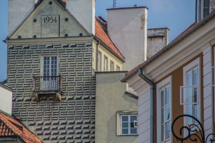 Painted houses Poland Warsaw Old Town Built Structure Building Exterior Architecture Building Window Low Angle View No People Day Nature Sunlight Roof History Residential District House Outdoors The Past Wall City Town Sky
