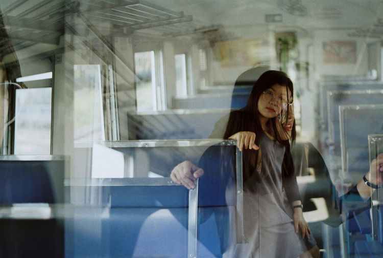 Multiple image of woman in bus