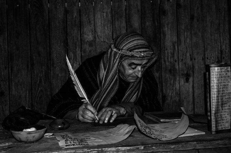 Close-up of man writing
