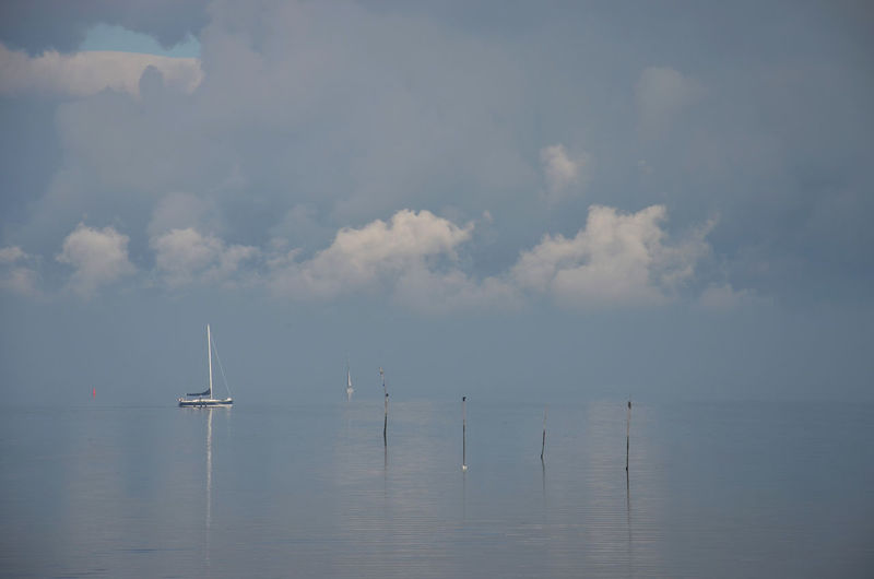 Water Sky Cloud - Sky Sea Waterfront Horizon Over Water Beauty In Nature Transportation Scenics - Nature Nature Tranquil Scene Horizon No People Tranquility Nautical Vessel Day Mode Of Transportation Sailboat Outdoors