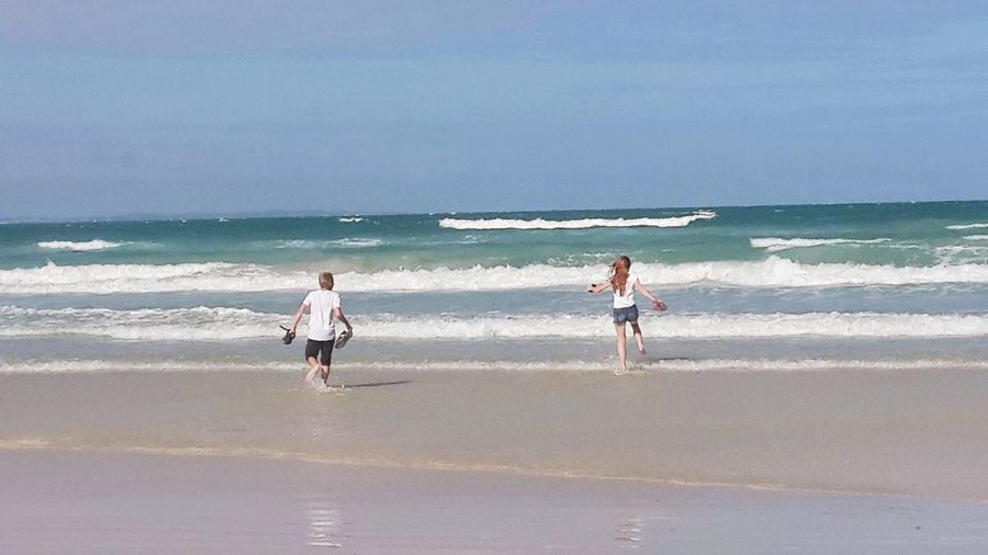 Let's see who gets there first. Beach Sea Sand Full Length Walking Wave Horizon Over Water Sunny Vacations People Water Fun Day Nature Two People Sky Outdoors Sunlight Summer Children Arniston South Africa The Week Of Eyeem Newest Talent