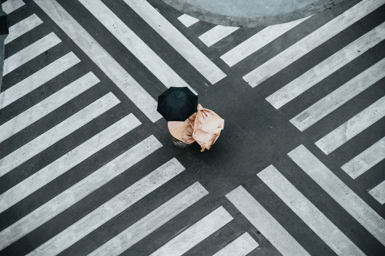 High angle view of man crossing road