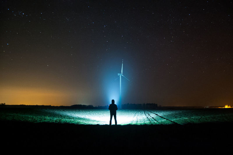 Night Sky Star - Space One Person Astronomy Silhouette Space Standing Beauty In Nature Real People Scenics - Nature Star Nature Rear View Land Star Field Lifestyles Tranquil Scene Illuminated Outdoors Flashlight Space And Astronomy Wind Turbine Renewable Energy
