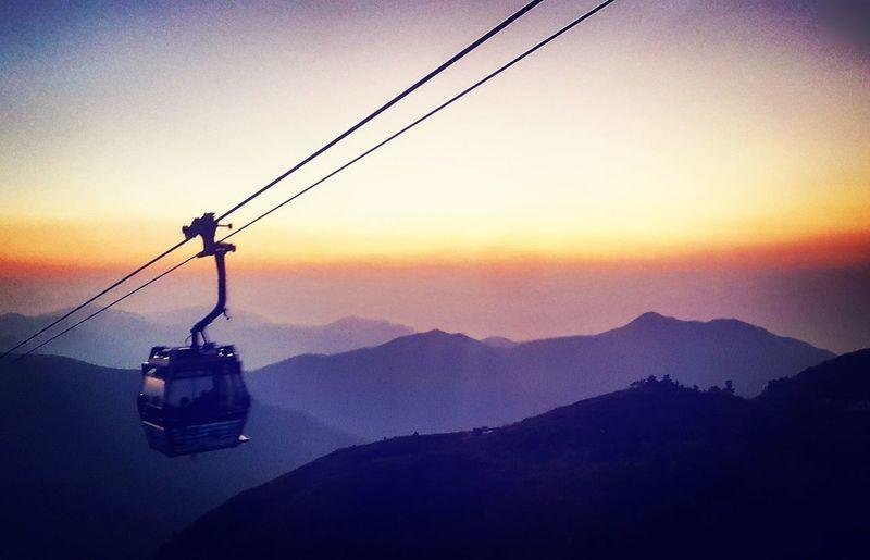 Hong Kong Big Buddha Lanta Island Ski Lift Overhead Cable Car Mountain Sunset Fog Hanging Cable Silhouette Sky Mountain Range