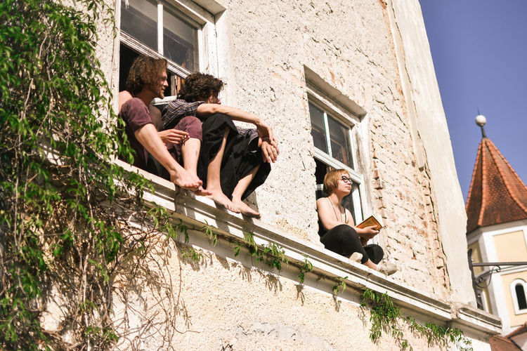 Hippie Architecture Built Structure Building Exterior Building Day Group Of People Women Men Adult Real People People Window Togetherness Nature Lifestyles Leisure Activity Low Angle View Sitting Full Length House Outdoors