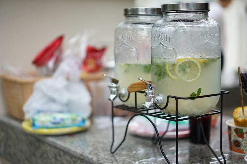 Close-up of lemonade in glass jars on table