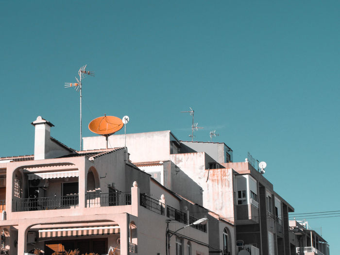 Orange antenna listening to the sky Orange Color Rooftop Residential District Residential Building Apartment Buildings SPAIN Holiday Destination Technology Antenna - Aerial Television Aerial Communication Wireless Technology Satellite Dish Roof Global Communications Architecture Building Exterior Satellite Orbiting Television Industry Antenna Radio Wave Radar Broadcasting