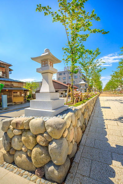 After Torii gate begins the Dankazura, a pathway flanked by cherry trees leading to Tsurugaoka Hachiman shinto sanctuary in Kamakura, Japan. Wakamiya-oji street offers spectacular landscapes in spring Kamakura, Japan - April 23, 2017: Komachi-dori Street, the shopping street outside Kamakura station. The popular touristic street is in ancient city of Kamakura with historic restaurants and stores. Dankazura Japan Japan Photography Japanese  Japanese Culture Japanese Temple Kamakura Kamakura Daibutsu Kamakura Japan Kamakura Station Path Road Shrine Shrine Of Japan Shrines & Temples Shrines And Temples Statue Wakamiya-Oji WakamiyaOji Architecture Blue Building Building Exterior Built Structure Day Direction Footpath Kamakura Sea Nature No People Outdoors Pathway Plant Religion Rock Sky Solid Spirituality Stone Stone - Object Stone Wall Street Sunlight Temple Tree Wakamiya