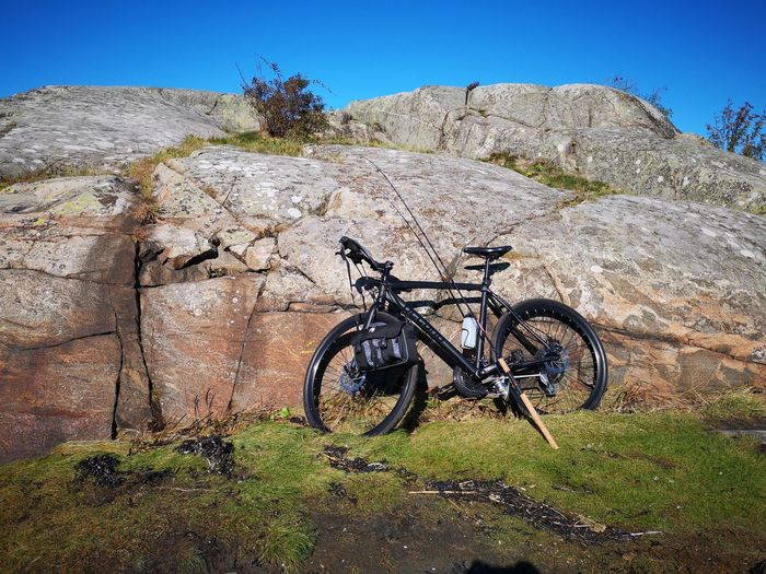 Bicycle Huaweiphotography Leicacamera Morning No Edit/no Filter Sweden Fishing Rod Blue Sky Cliffs Bicycle Sunlight Sky Grass Tranquility Non-urban Scene Coast Shore