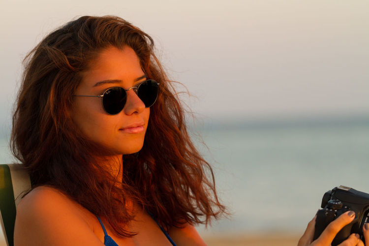 Close-up of young woman on beach
