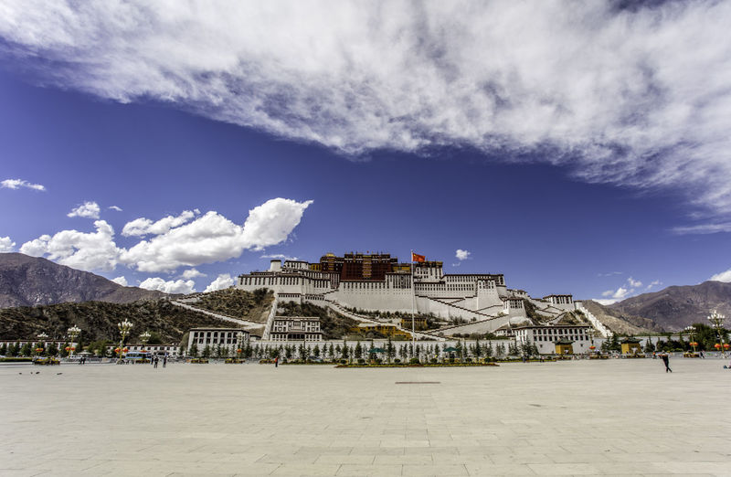 Low Angle View Of Potala Palace Against Cloudy Sky