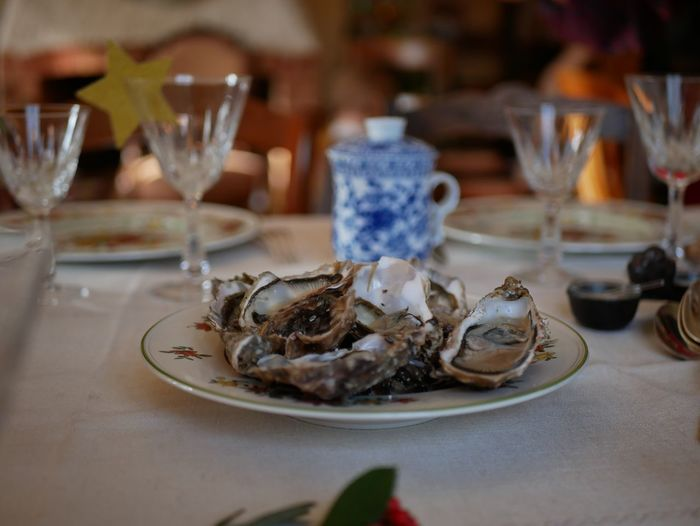 Close-up of oysters in plate on table