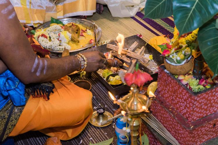 Side view of sadhu performing prayer