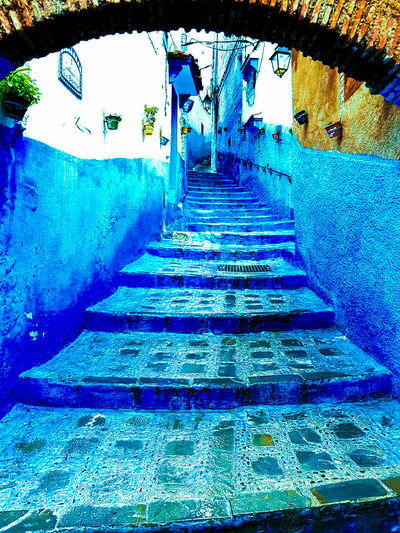 Stairs leading to blue wall