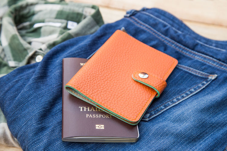 travel Adult Blue Body Part Book Casual Clothing Close-up Communication Denim Focus On Foreground Human Body Part Indoors  Jeans Lifestyles Midsection People Pocket  Publication Textile
