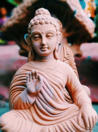 Close-up of buddha idol at workshop