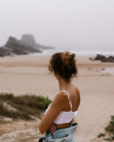 Woman on the beach on a cloudy day