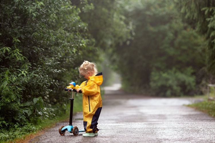 Side view of a boy walking on road
