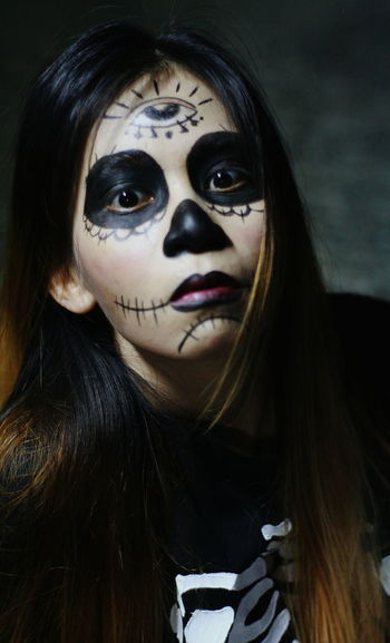 Close-up portrait of beautiful woman with face paint during halloween