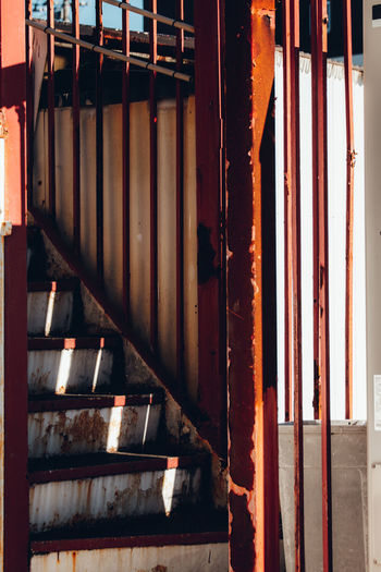 Color Redefining Red Minimal Light And Shadow Fine Art Streetphotography Abstract Exceptional Normalcy Simplicity Japan Retro Nostalgia Street Staircase Stairs Old Built Structure Lines Minimalism No People Architecture Day Metal Indoors  Sunlight Building Nature Industry Wood - Material Rusty Wall - Building Feature Pattern In A Row Side By Side Shadow Weathered Iron