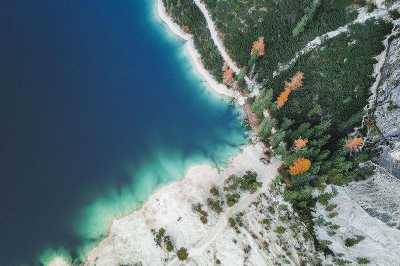High angle view of rocks by lake