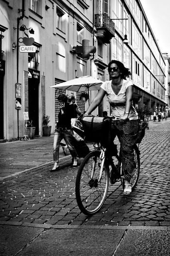 City rider. Adult Bicycle Bicycle Rider Bike Black And White Black And White Photography Bnw City City Life Lifestyles Olympus Om-d E-m10 Outdoors People Person Street Street Life Street Photography Torino Italy Transportation Transportation Vehicle Turin Turin Italy Walking People Young Women Monochrome Photography Stories From The City