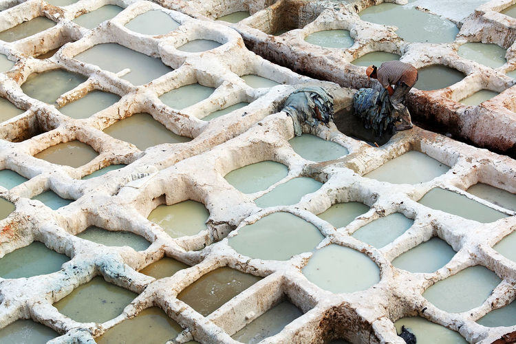 High angle view of man working at the tannery