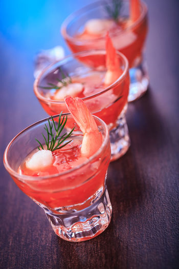 close up shot of a shrimp cocktail Shrimp Shrimp Soup Alcohol Citrus Fruit Close-up Cocktail Drink Drinking Glass Food Food And Drink Freshness Fruit Garnish GIN Glass Glass - Material Healthy Eating Herb Household Equipment Indoors  Mint Leaf - Culinary No People Refreshment Sea Food Table Transparent