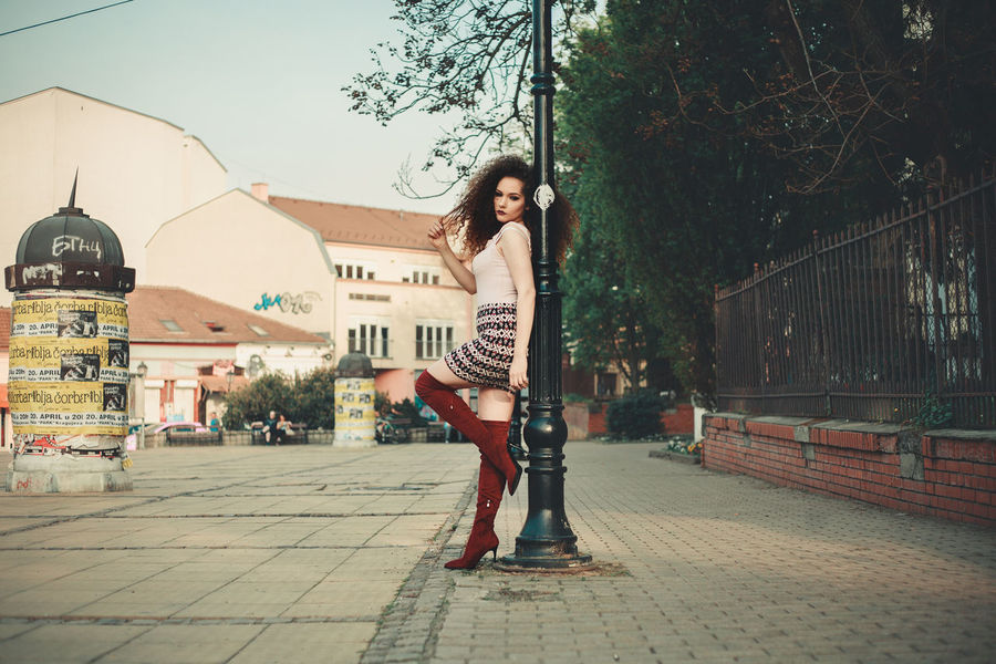 Curly girl posing on the streat Portrait Of A Woman Adult Architecture Beautiful Woman Beauty Building Exterior Built Structure Casual Clothing Curly Hair Fashion Full Length Hair Hairstyle Leisure Activity Lifestyles Outdoors Portrait Portrait, Posing Real People Women Young Adult Young Women