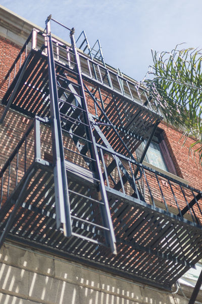 building fire escape Arch Blue Sky Building City Day Fire Escape Glow Ladder Low Angle View Metal Ladder Metal Staircase Metal Stairs Metal Structure No People Outdoors Palm Tree Red Brick Building Reflcetions Shallow Depth Of Field Sky Urban Window