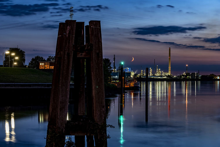 Harbourscape Capture Tomorrow Water Sky Cloud - Sky Architecture Building Exterior Built Structure Reflection Illuminated Waterfront Nature No People Night City Dusk River Building Outdoors Travel Destinations Skyscraper Wooden Post