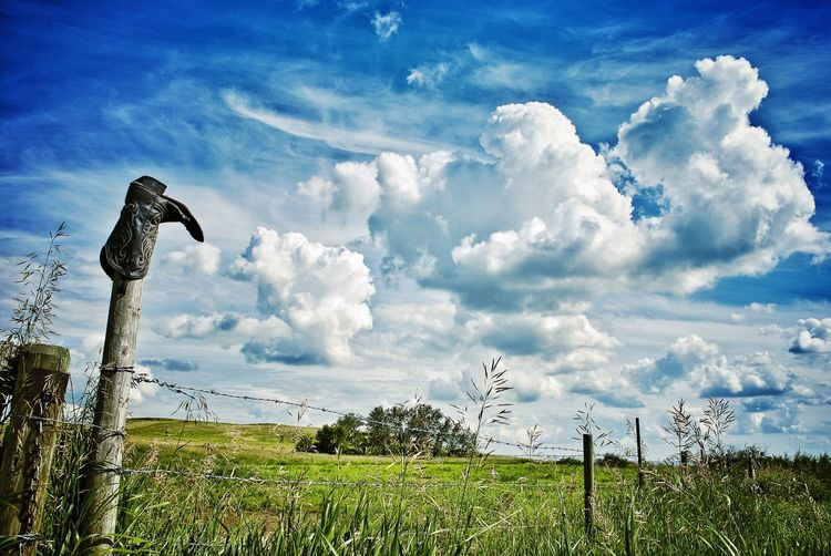 Canadian Prairie Prairie Wilderness Boots Lether Fence Sky Day Field Cloud - Sky Nature Outdoors Grass No People Wooden Post Beauty In Nature