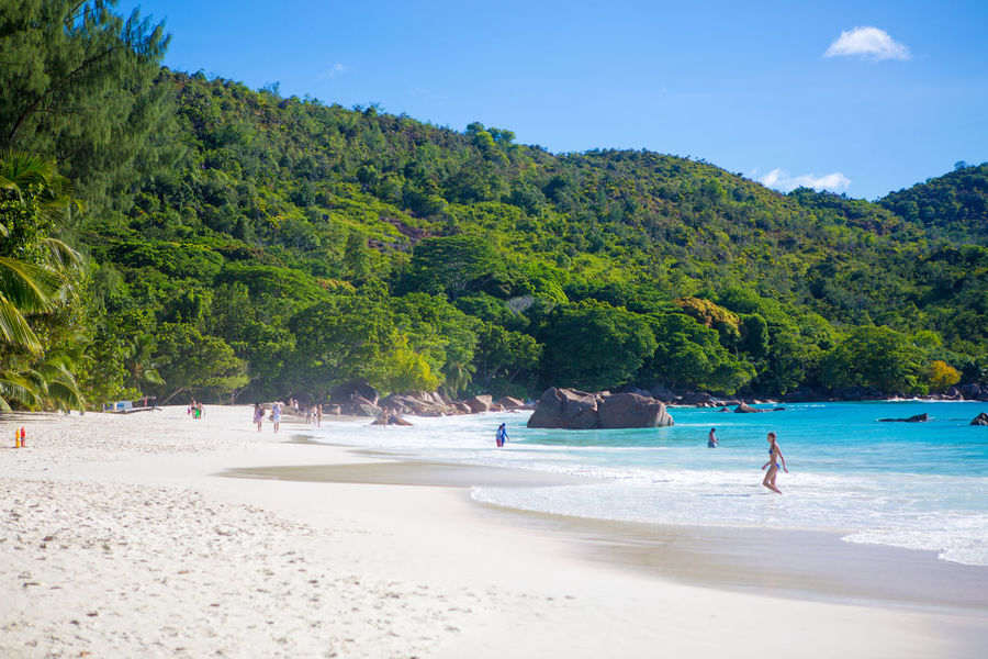 La Digue Anse Lazio Anse Source D'argent Beach Beauty In Nature Blue Coastline Mahé Nature Outdoors People Praslin Seychelles Relaxation Sand Sea Shadow Sky Summer Sunlight Sunny Tourism Travel Destinations Tree Vacations Water