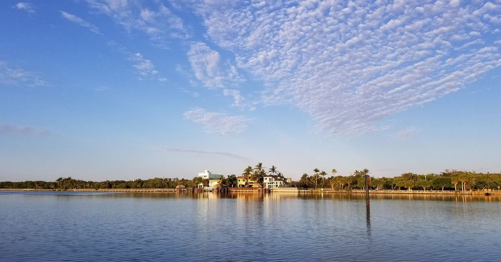 EyeEm Selects Tree Water Blue Lake Full Length Sky