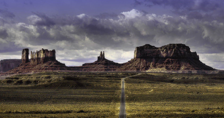 Monument Valley is a scene of beauty and many western style movies Scenics - Nature Nature No People Monument Valley Tribal Park Park Rocks Mountains Desert Adventure Movie Films John Wayne Travel Destinations Travel Photography Nature Nature Photography Hiking Camping Landscape Landscape Photography Color Sky Outdoors Rock Formation Road Landmark