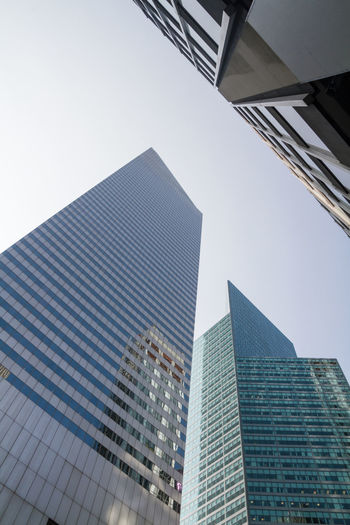 Skyscrapers Architecture Building Building Exterior Built Structure City City Life Day Development Financial District  Looking Up Low Angle View Modern New York No People Office Building Outdoors Sky Skyscraper Tall Tall - High Tower
