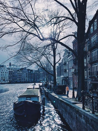 Canal And Waterway Canal Yellow Tree Transportation Architecture Winter City Building Exterior Snow Mode Of Transportation Built Structure Cold Temperature Water Street Outdoors