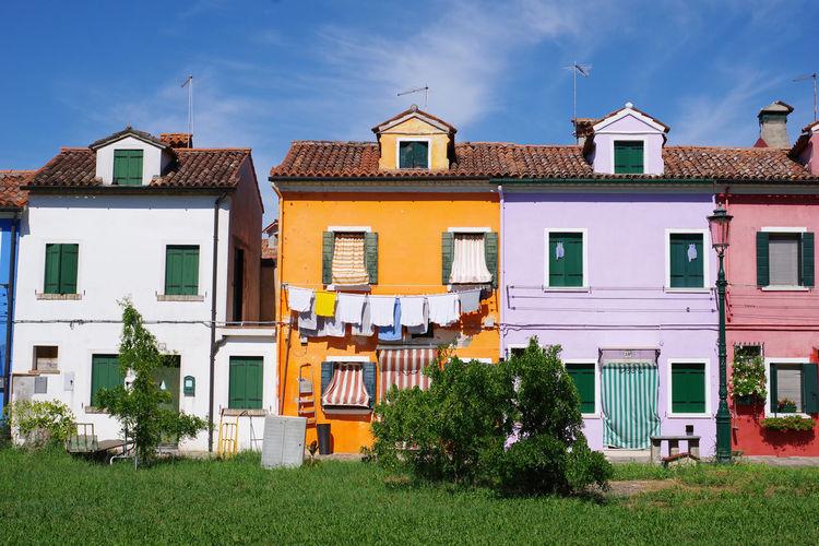 Residential buildings against sky in town