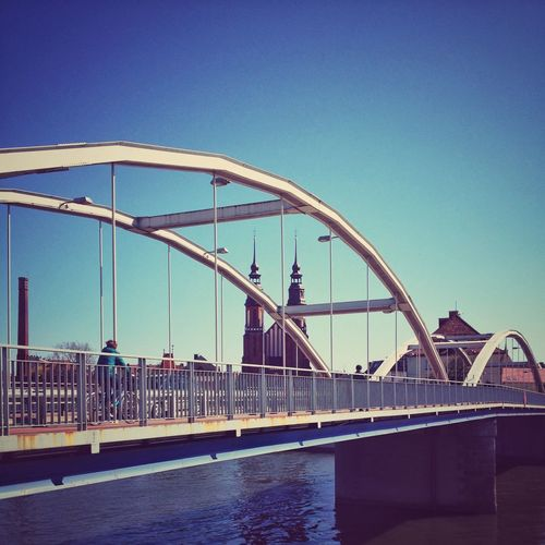 View of bridge against clear blue sky